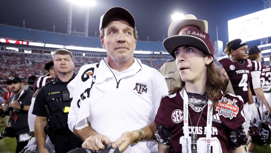 JACKSONVILLE, FL - DECEMBER 31: Head coach Jimbo Fisher of the Texas A&M Aggies with his son Ethan after a win against the North Carolina State Wolfpack in the TaxSlayer Gator Bowl at TIAA Bank Field on December 31, 2018 in Jacksonville, Florida. Texas A&M won 52-13. (Photo by Joe Robbins/Getty Images)