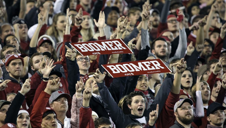 NORMAN, OK - NOVEMBER 11: Oklahoma Sooners fans cheer during the game against the TCU Horned Frogs at Gaylord Family Oklahoma Memorial Stadium on November 11, 2017 in Norman, Oklahoma. Oklahoma defeated TCU 38-20. (Photo by Brett Deering/Getty Images) *** Local Caption ***