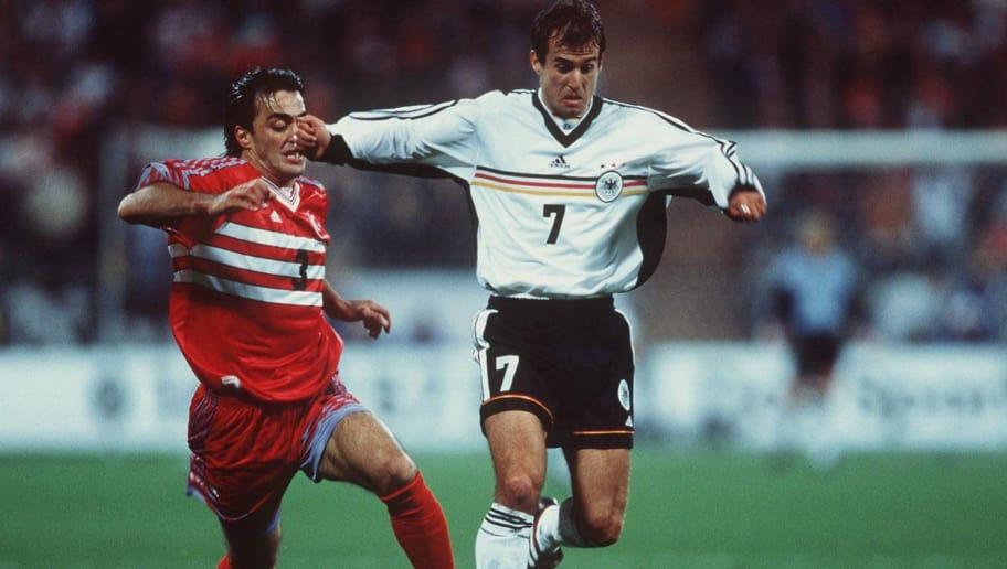 MUNICH, GERMANY - OCTOBER 09:  EM QUALIFIKATION 1999, DEUTSCHLAND - TUERKEI 0:0, Muenchen; Oguen TEMIZKANOGLU/TUR, Mehmet SCHOLL/GER  (Photo by Mark Sandten/Bongarts/Getty Images)