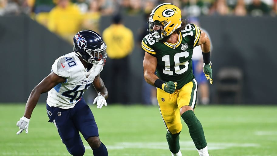 GREEN BAY, WI - AUGUST 09:  Jake Kumerow #16 of the Green Bay Packers works against Rico Gafford #40 of the Tennessee Titans during a preseason game at Lambeau Field on August 9, 2018 in Green Bay, Wisconsin.  The Packers defeated the Titans 31-17.  (Photo by Stacy Revere/Getty Images)
