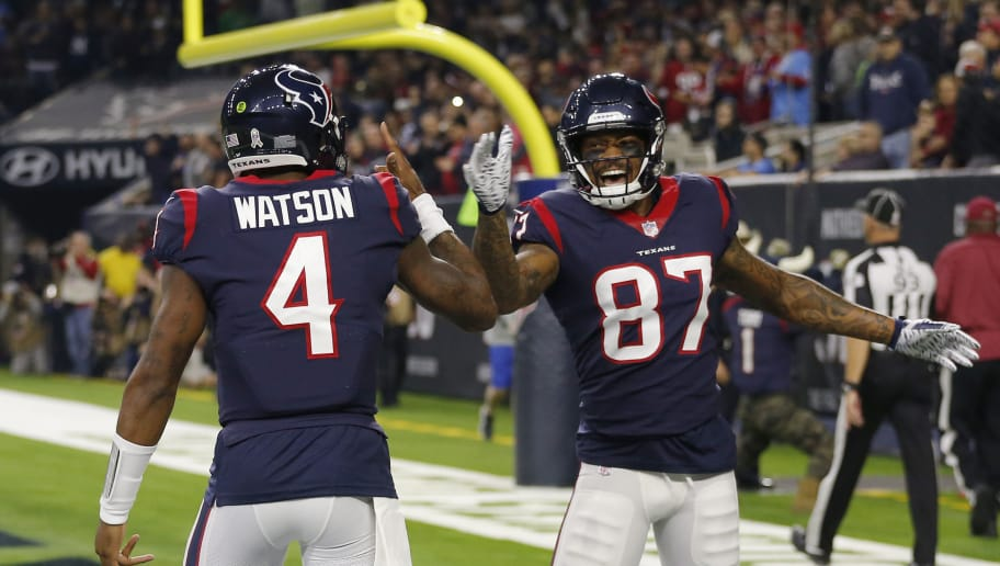 HOUSTON, TEXAS - NOVEMBER 26:   Demaryius Thomas #87 of the Houston Texans celebrates with Deshaun Watson #4 after catching a pass for a touchdown against the Tennessee Titans during the first quarter at NRG Stadium on November 26, 2018 in Houston, Texas. (Photo by Bob Levey/Getty Images)
