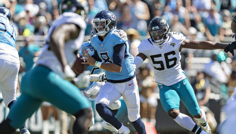 JACKSONVILLE, FL - SEPTEMBER 23:  Dante Fowler Jr. #56 of the Jacksonville Jaguars chases down and tackles Marcus Mariota #8 of the Tennessee Titans at TIAA Bank Field on September 23, 2018 in Jacksonville, Florida.  The Titans defeated the Jaguars 9-6.  (Photo by Wesley Hitt/Getty Images)