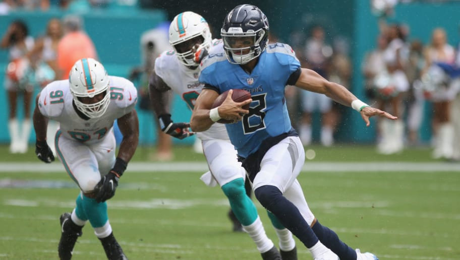 MIAMI, FL - SEPTEMBER 09:  Quarterback Marcus Mariota #8 of the Tennessee Titans scrambles against the Miami Dolphins at Hard Rock Stadium on September 9, 2018 in Miami, Florida. The Dolphins defeated  the Titans 27-20 after two rain delays in the longest game in NFL history.  (Photo by Marc Serota/Getty Images)
