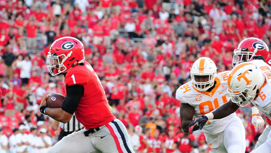 ATHENS, GA - SEPTEMBER 29: Justin Fields #1 of the Georgia Bulldogs runs the ball against the Tennessee Volunteers on September 29, 2018 at Sanford Stadium in Athens, Georgia. (Photo by Scott Cunningham/Getty Images)