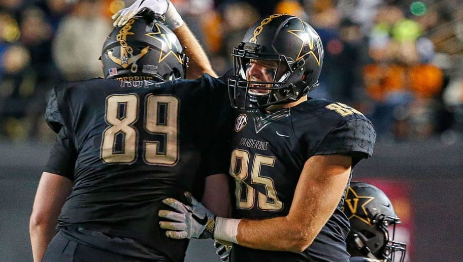 NASHVILLE, TN - NOVEMBER 24:  Gavin Schoenwald #85 of the Vanderbilt Commodores bumps teammate Braden Kopp #89 during a 38-13 victory over the University of Tennessee at Vanderbilt Stadium on November 24, 2018 in Nashville, Tennessee.  (Photo by Frederick Breedon/Getty Images)