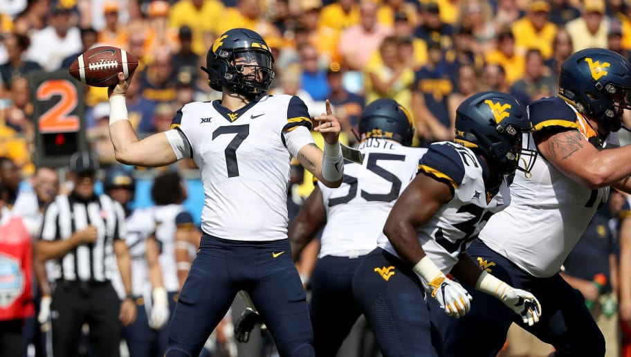 CHARLOTTE, NC - SEPTEMBER 01:  Will Grier #7 of the West Virginia Mountaineers drops back to pass against the Tennessee Volunteers during their game at Bank of America Stadium on September 1, 2018 in Charlotte, North Carolina.  (Photo by Streeter Lecka/Getty Images)