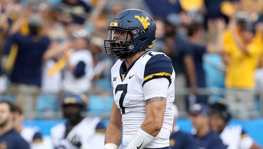 CHARLOTTE, NC - SEPTEMBER 01:  Will Grier #7 of the West Virginia Mountaineers reacts after throwing a touchdown pass against the Tennessee Volunteers during their game at Bank of America Stadium on September 1, 2018 in Charlotte, North Carolina.  (Photo by Streeter Lecka/Getty Images)