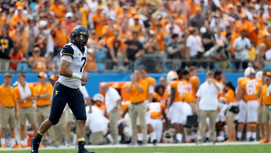 CHARLOTTE, NC - SEPTEMBER 01:  Will Grier #7 of the West Virginia Mountaineers watches on against the Tennessee Volunteers during their game at Bank of America Stadium on September 1, 2018 in Charlotte, North Carolina.  (Photo by Streeter Lecka/Getty Images)
