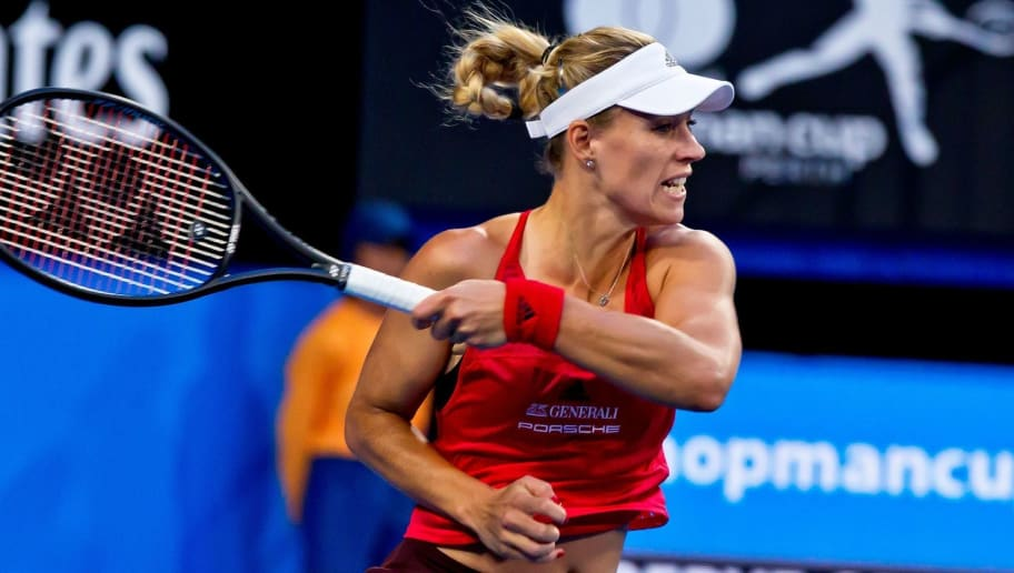 Angelique Kerber of Germany hits a return against Thanasi Kokkinakis of Australia during their twelfth session mixed doubles match on day seven of the Hopman Cup tennis tournament in Perth on January 5, 2018 / AFP PHOTO / TONY ASHBY / RESTRICTED TO EDITORIAL USE - STRICTLY NO COMMERCIAL USE / The erroneous mention[s] appearing in the metadata of this photo by TONY ASHBY has been modified in AFP systems in the following manner: [Angelique Kerber of Germany] instead of [Alexander Zverev of Germany]. Please immediately remove the erroneous mention[s] from all your online services and delete it (them) from your servers. If you have been authorized by AFP to distribute it (them) to third parties, please ensure that the same actions are carried out by them. Failure to promptly comply with these instructions will entail liability on your part for any continued or post notification usage. Therefore we thank you very much for all your attention and prompt action. We are sorry for the inconvenience this notification may cause and remain at your disposal for any further information you may require.        (Photo credit should read TONY ASHBY/AFP/Getty Images)