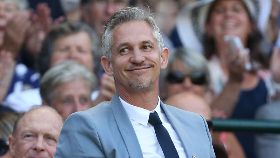Former England footballer and television presenter Gary Lineker stands and waves in the royal box on centre court before the start of the men's singles third round match between Australia's Samuel Groth and Switzerland's Roger Federer on day six of the 2015 Wimbledon Championships at The All England Tennis Club in Wimbledon, southwest London, on July 4, 2015.   RESTRICTED TO EDITORIAL USE  --   AFP PHOTO / JUSTIN TALLIS        (Photo credit should read JUSTIN TALLIS/AFP/Getty Images)