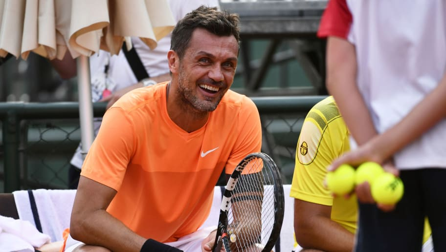AC Milan's former player Paolo Maldini reacts during the men's doubles tennis match, with his partner Stefano Landonio against Poland's player Tomasz Bednarek and Nederland's player David Pel during the ATP Challenger Tour on June 27, 2017 at the Aspria Tennis Club in Milan.  / AFP PHOTO / Marco BERTORELLO        (Photo credit should read MARCO BERTORELLO/AFP/Getty Images)