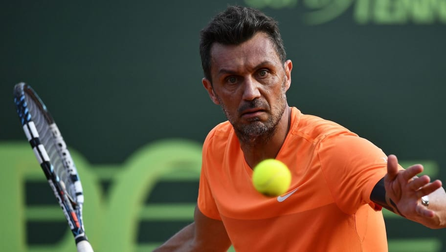 AC Milan's former player Paolo Maldini returns the ball during the men's doubles tennis match, with his partner Stefano Landonio against Poland's player Tomasz Bednarek and Nederland's player David Pel during the ATP Challenger Tour on June 27, 2017 at the Aspria Tennis Club in Milan.  / AFP PHOTO / Marco BERTORELLO        (Photo credit should read MARCO BERTORELLO/AFP/Getty Images)