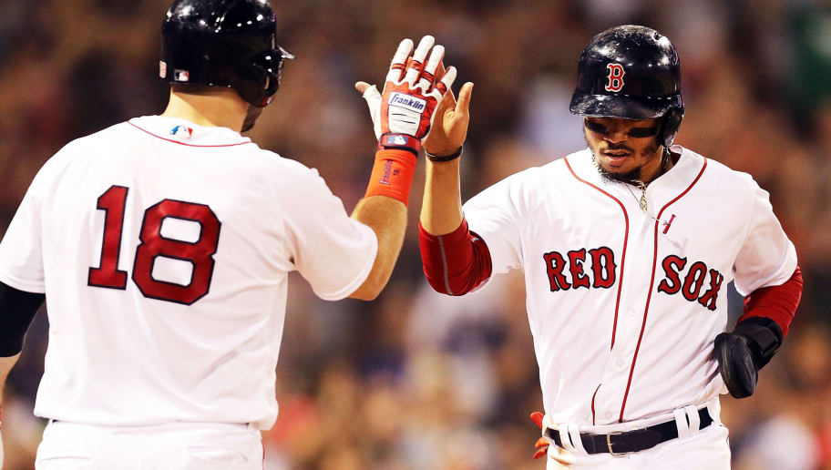 BOSTON, MA - JULY 10:  Mookie Betts #50 high fives Mitch Moreland #18 of the Boston Red Sox as he returns to the dugout after scoring in the seventh inning of a game against the Texas Rangers at Fenway Park on July 10, 2018 in Boston, Massachusetts.  (Photo by Adam Glanzman/Getty Images)