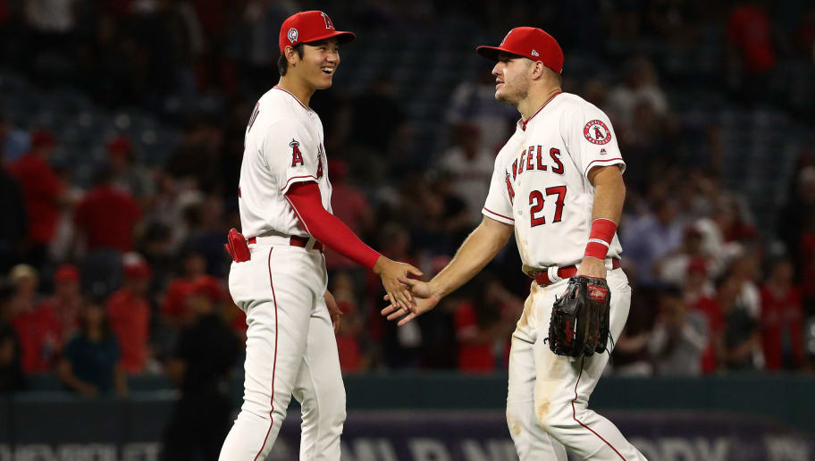 ANAHEIM, CA - SEPTEMBER 11: Shohei Ohtani #17 and Mike Trout #27 of the Los Angeles Angels of Anaheim celebrate after the MLB game at Angel Stadium on September 11, 2018 in Anaheim, California. The Angels defeated the Rangers 1-0.  (Photo by Victor Decolongon/Getty Images)