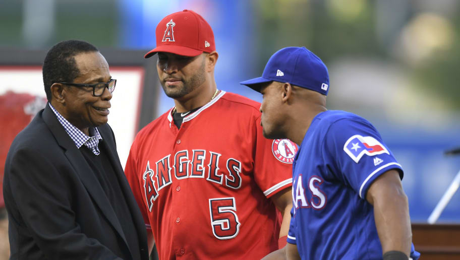 ANAHEIM, CA - JUNE 02: (l-r) Hall of Famer Rod Carew, Albert Pujols #5 of the Los Angeles Angels of Anaheim and Adrian Beltre #29 of the Texas Rangers share a moment after a ceremony honoring Pujols 3000 career hits at Angel Stadium on June 2, 2018 in Anaheim, California. (Photo by John McCoy/Getty Images)