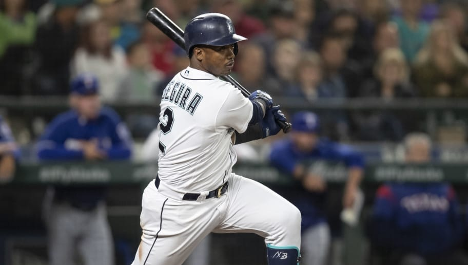 SEATTLE, WA - SEPTEMBER 29: Jean Segura #2 of the Seattle Mariners takes a swing during an at-bat in a game against the Texas Rangers at Safeco Field on September 29, 2018 in Seattle, Washington. The Mariners won the game 4-1. (Photo by Stephen Brashear/Getty Images)