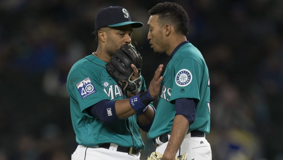 SEATTLE, WA - MAY 5: Relief pitcher Edwin Diaz #39, right, of the Seattle Mariners talks with second baseman Robinson Cano #22 of the Seattle Mariners before taking the mound during a game against the Texas Rangers at Safeco Field on May 5, 2017 in Seattle, Washington. The Rangers won the game 3-1 in 13 innings. (Photo by Stephen Brashear/Getty Images)