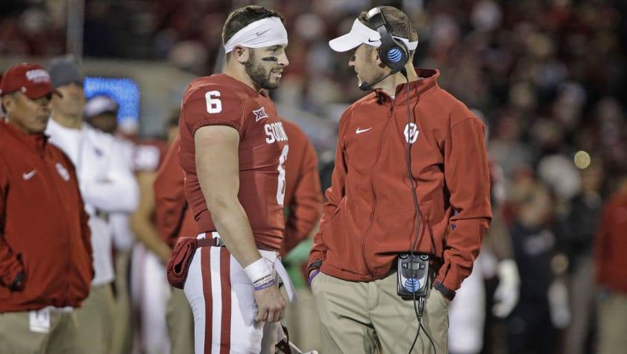 NORMAN, OK - OCTOBER 28: Quarterback Baker Mayfield #6 and head coach Lincoln Riley of the Oklahoma Sooners confer during a play review during the game against the Texas Tech Red Raiders at Gaylord Family Oklahoma Memorial Stadium on October 28, 2017 in Norman, Oklahoma. Oklahoma defeated Texas Tech 49-27. (Photo by Brett Deering/Getty Images)