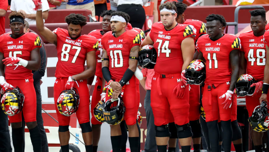 LANDOVER, MD - SEPTEMBER 1: Members of the Maryland Terrapins observe a moment of silence in memory of former Terrapin player Jordan McNair who died earlier in the year during a workout, before the start of their game against the Texas Longhorns at FedExField on September 1, 2018 in Landover, Maryland. (Photo by Rob Carr/Getty Images)