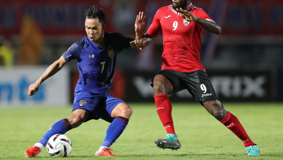 SUPHAN BURI, THAILAND - OCTOBER 14: Sumanya Purisay #7 of Thailand (L) controls the ball under pressure of Khaleem Hyland #9 of Trinidad and Tobago (R) during the international friendly match between Thailand and Trinidad and Tobago at Suphanburi Stadium on October 14, 2018 in Suphan Buri, Thailand. (Photo by Pakawich Damrongkiattisak/Getty Images)