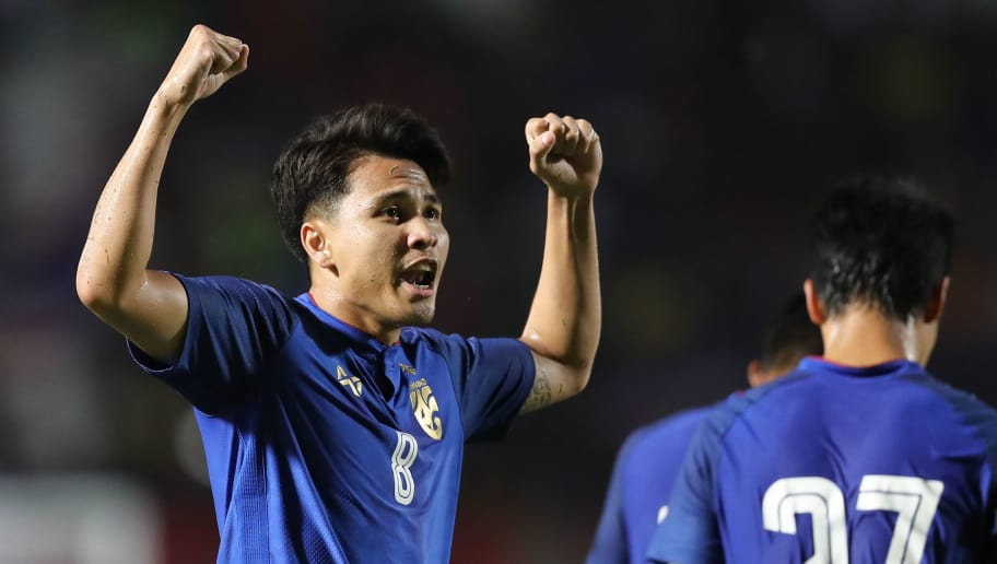 SUPHAN BURI, THAILAND - OCTOBER 14: Thitiphan Puangjan #8 of Thailand (L) celebrates scoring his side's goal during the international friendly match between Thailand and Trinidad and Tobago at Suphanburi Stadium on October 14, 2018 in Suphan Buri, Thailand. (Photo by Pakawich Damrongkiattisak/Getty Images)