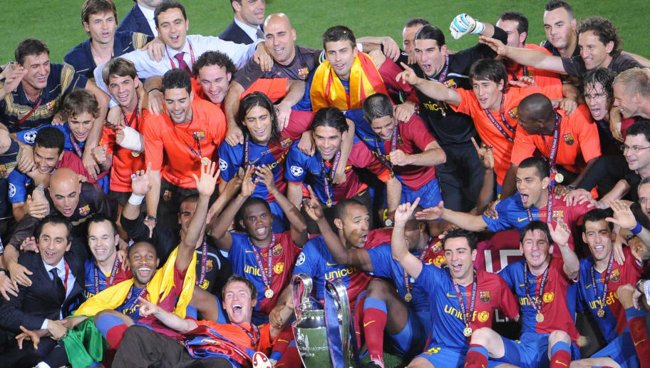 The Barcelona team pose with the cup as they celebrate after winning the UEFA football Champions League final against Manchester United on May 27, 2009 at the Olympic Stadium in Rome.    AFP PHOTO / ALBERTO PIZZOLI (Photo credit should read ALBERTO PIZZOLI/AFP/Getty Images)