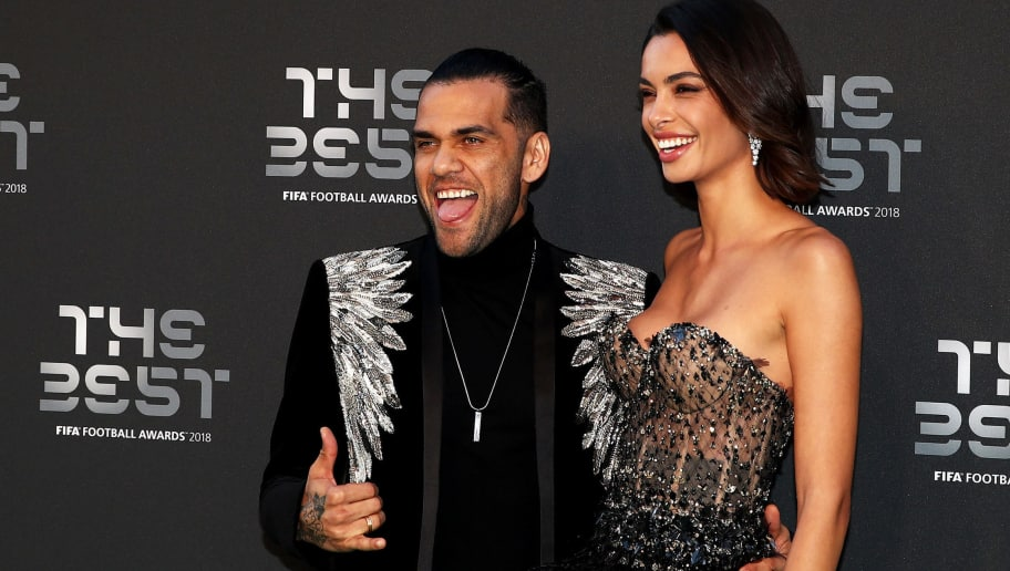 LONDON, ENGLAND - SEPTEMBER 24:  Dani Alves of Paris Saint-Germain (L) and Joana Sanz arrive on the Green Carpet ahead of The Best FIFA Football Awards at Royal Festival Hall on September 24, 2018 in London, England.  (Photo by Julian Finney/Getty Images)