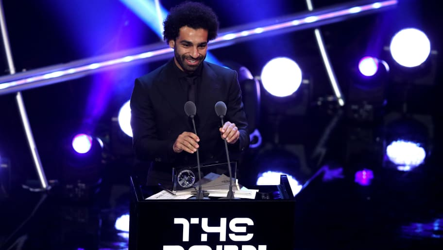 LONDON, ENGLAND - SEPTEMBER 24:  Mohamed Salah of Liverpool wins the trophy for the FIFA Puskas Award 2018 during the The Best FIFA Football Awards Show at Royal Festival Hall on September 24, 2018 in London, England.  (Photo by Dan Istitene/Getty Images)