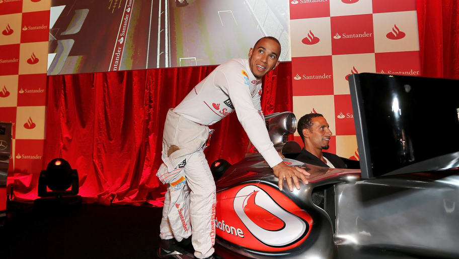 LONDON, ENGLAND - JUNE 28:  F1 driver Lewis Hamilton (L) and footballer Rio Ferdinand attend the launch of the London Grand Prix by Santander at the Royal Automobile Club on June 28, 2012 in London, England.  (Photo by Mark Thompson/Getty Images)