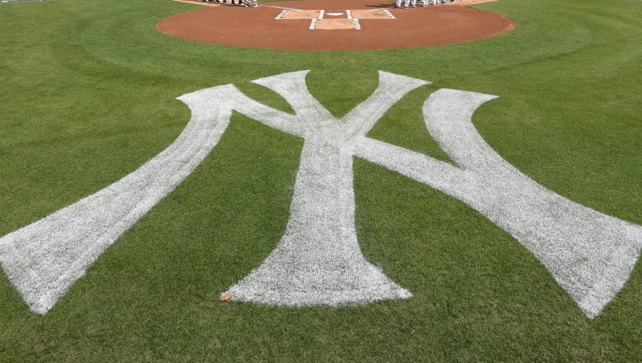 TAMPA, FL - FEBRUARY 23:  A general view of George M. Steinbrenner Field as players and coaches from the Detroit Tigers and the New York Yankees line-up during the National Anthem prior to the Spring Training game at George M. Steinbrenner Field on February 23, 2018 in Tampa, Florida. The Yankees defeated the Tigers 3-1.  (Photo by Mark Cunningham/MLB Photos via Getty Images)