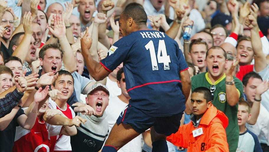 LONDON - AUGUST 24:   Thierry Henry of Arsenal celebrates his goal during the FA Barclaycard Premiership match between West Ham United and Arsenal at Upton Park, London on August 24, 2002. (Photo by Phil Cole/Getty Images)