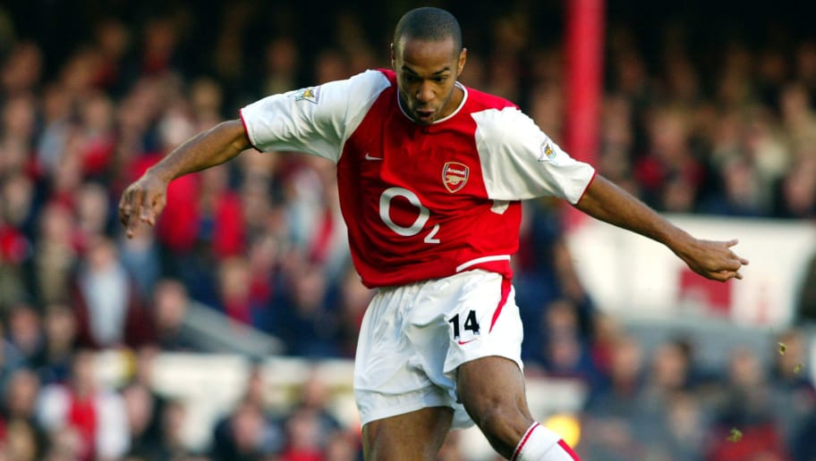 LONDON - NOVEMBER 16:  Thierry Henry of Arsenal in action during the FA Barclaycard Premiership match between Arsenal and Tottenham Hotspur on November 16, 2002 played at Highbury in London, England. Arsenal won the match 3-0. (Photo By Ben Radford/Getty Images)