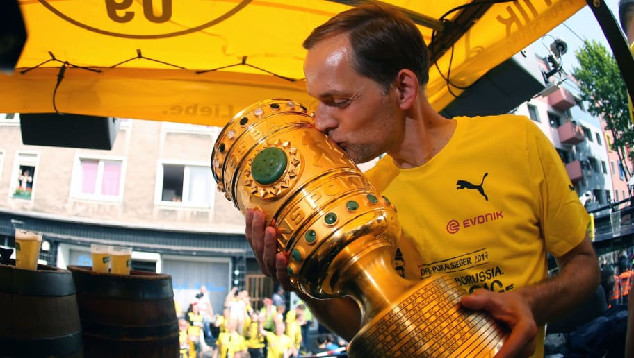 Dortmund's head coach Thomas Tuchel kisses the trophy as they arrive at Borsigplatz during celebrations after winning the German Cup final (DFB Pokalfinale) in Dortmund, western Germany, on May 28, 2017. / AFP PHOTO / POOL / Ina FASSBENDER        (Photo credit should read INA FASSBENDER/AFP/Getty Images)