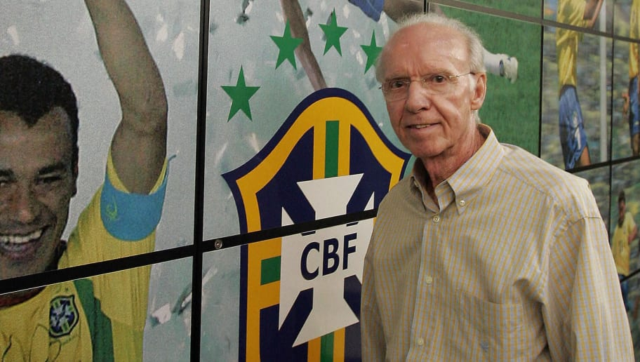 Rio de Janeiro, BRAZIL:  TO GO WITH AFP STORY (FILE) Four-time World Cup winner Mario Zagallo poses, 03 May 2006, in front of a panel at the headquaters of the Brazilian Football Confederation in Rio de Janeiro, Brazil. Zagallo won the World Cup as a player in 1958 and 1962, as a coach in 1970 and as technical director to Carlos Parreira in 1994. He also coached Brazil to the 1998 final where they lost to France.  AFP PHOTO /Antonio SCORZA/FILES  (Photo credit should read ANTONIO SCORZA/AFP/Getty Images)