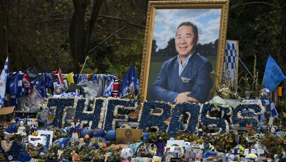 TOPSHOT - An image of Leicester City's Thai chairman Vichai Srivaddhanaprabha is pictured amogst floral tributes left outside the King Power Stadium in Leicester, central England on November 28, 2018. - Leicester City's chairman Vichai Srivaddhanaprabha was among five people killed when his helicopter crashed and burst into flames in the Premier League side's stadium car park moments after taking off from the pitch on October 27. (Photo by Paul ELLIS / AFP)        (Photo credit should read PAUL ELLIS/AFP/Getty Images)