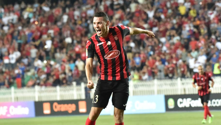 TOPSHOT - CORRECTION - Algeria's USMA player Oussama Darfalou celebrates after scoring during the CAF Champions League group stage football match between USM Alger and Caps United Football Club of Zimbabwe at the 5 Juillet 1962 stadium in Algiers on July 9, 2017.  / AFP PHOTO / RYAD KRAMDI / The erroneous mention[s] appearing in the metadata of this photo by RYAD KRAMDI has been modified in AFP systems in the following manner: [on July 9, 2017] instead of [on July 7, 2017]. Please immediately remove the erroneous mention[s] from all your online services and delete it (them) from your servers. If you have been authorized by AFP to distribute it (them) to third parties, please ensure that the same actions are carried out by them. Failure to promptly comply with these instructions will entail liability on your part for any continued or post notification usage. Therefore we thank you very much for all your attention and prompt action. We are sorry for the inconvenience this notification may cause and remain at your disposal for any further information you may require.        (Photo credit should read RYAD KRAMDI/AFP/Getty Images)