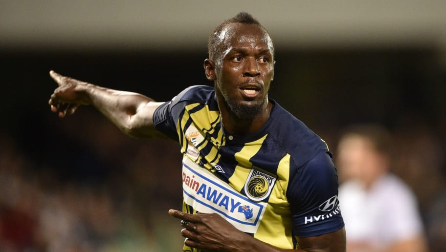 TOPSHOT - Olympic sprinter Usain Bolt celebrates scoring a goal for A-League football club Central Coast Mariners in his first competitive start for the club against Macarthur South West United in Sydney on October 12, 2018. (Photo by PETER PARKS / AFP) / -- IMAGE RESTRICTED TO EDITORIAL USE - STRICTLY NO COMMERCIAL USE --        (Photo credit should read PETER PARKS/AFP/Getty Images)