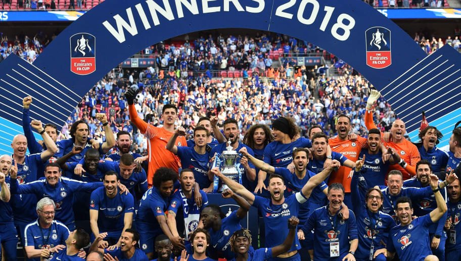 TOPSHOT - Chelsea players celebrate with the trophy after their victory in the English FA Cup final football match between Chelsea and Manchester United at Wembley stadium in London on May 19, 2018. - Chelsea won the game 1-0. (Photo by Glyn KIRK / AFP) / NOT FOR MARKETING OR ADVERTISING USE / RESTRICTED TO EDITORIAL USE        (Photo credit should read GLYN KIRK/AFP/Getty Images)