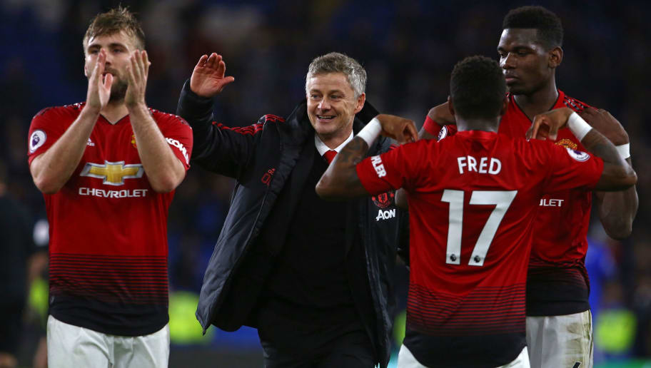 TOPSHOT - Manchester United's Norwegian caretaker manager Ole Gunnar Solskjaer (C) celebrates with his players on the pitch after the English Premier League football match between between Cardiff City and Manchester United at Cardiff City Stadium in Cardiff, south Wales on  December 22, 2018. - Manchester United won the game 5-1. (Photo by Geoff CADDICK / AFP) / RESTRICTED TO EDITORIAL USE. No use with unauthorized audio, video, data, fixture lists, club/league logos or 'live' services. Online in-match use limited to 120 images. An additional 40 images may be used in extra time. No video emulation. Social media in-match use limited to 120 images. An additional 40 images may be used in extra time. No use in betting publications, games or single club/league/player publications. /         (Photo credit should read GEOFF CADDICK/AFP/Getty Images)
