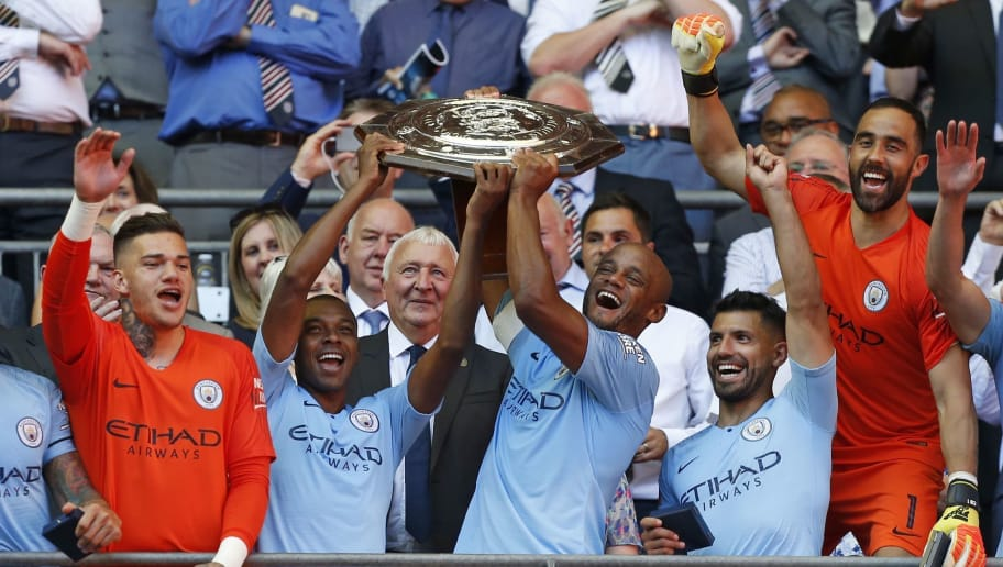 TOPSHOT - Manchester City's Belgian defender Vincent Kompany (centre right) and Manchester City's Brazilian midfielder Fernandinho (centre left) lift the FA Community Shield as Manchester City players celebrate their victory after the English FA Community Shield football match between Chelsea and Manchester City at Wembley Stadium in north London on August 5, 2018. - Manchester City won the game 2-0. (Photo by Ian KINGTON / AFP) / NOT FOR MARKETING OR ADVERTISING USE / RESTRICTED TO EDITORIAL USE        (Photo credit should read IAN KINGTON/AFP/Getty Images)