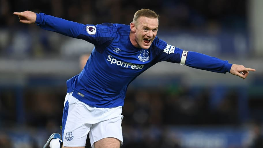 TOPSHOT - Everton's English striker Wayne Rooney celebrates scoring their second goal during the English Premier League football match between Everton and West Ham United at Goodison Park in Liverpool, north west England on November 29, 2017. / AFP PHOTO / Paul ELLIS / RESTRICTED TO EDITORIAL USE. No use with unauthorized audio, video, data, fixture lists, club/league logos or 'live' services. Online in-match use limited to 75 images, no video emulation. No use in betting, games or single club/league/player publications.  /         (Photo credit should read PAUL ELLIS/AFP/Getty Images)