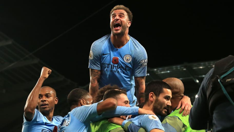 TOPSHOT - Manchester City's German midfielder Ilkay Gundogan celebrates after scoring their third goal during the English Premier League football match between Manchester City and Manchester United at the Etihad Stadium in Manchester, north west England, on November 11, 2018. (Photo by Lindsey PARNABY / AFP) / RESTRICTED TO EDITORIAL USE. No use with unauthorized audio, video, data, fixture lists, club/league logos or 'live' services. Online in-match use limited to 120 images. An additional 40 images may be used in extra time. No video emulation. Social media in-match use limited to 120 images. An additional 40 images may be used in extra time. No use in betting publications, games or single club/league/player publications. /         (Photo credit should read LINDSEY PARNABY/AFP/Getty Images)