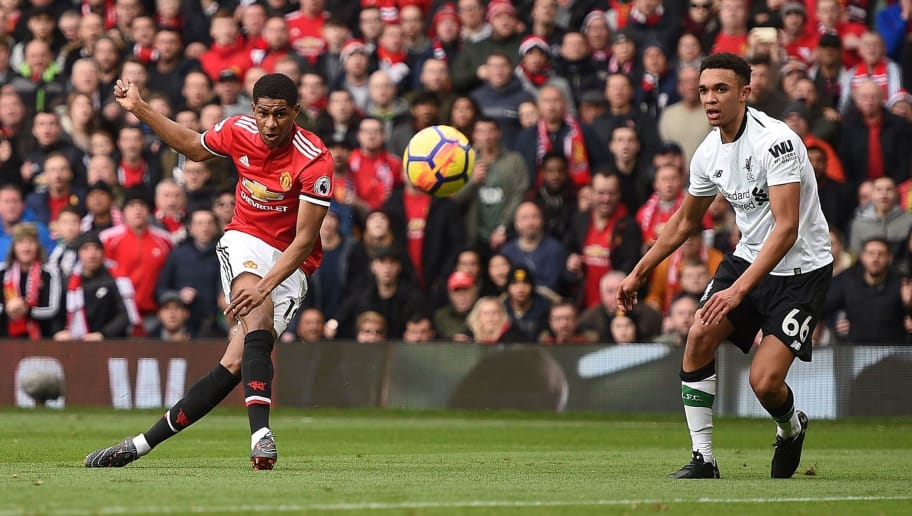 TOPSHOT - Manchester United's English striker Marcus Rashford (L) scores the opening goal during the English Premier League football match between Manchester United and Liverpool at Old Trafford in Manchester, north west England, on March 10, 2018. / AFP PHOTO / Oli SCARFF / RESTRICTED TO EDITORIAL USE. No use with unauthorized audio, video, data, fixture lists, club/league logos or 'live' services. Online in-match use limited to 75 images, no video emulation. No use in betting, games or single club/league/player publications.  /         (Photo credit should read OLI SCARFF/AFP/Getty Images)
