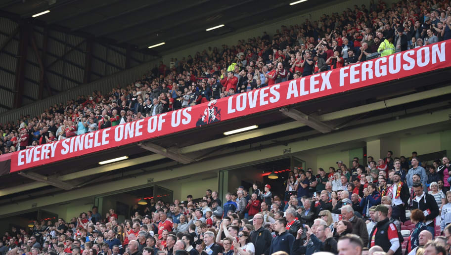 TOPSHOT - A banner wishing former manager Alex Ferguson, who is convalescing after having emergency surgery on a brain haemorrhage, is seen during the English Premier League football match between Manchester United and Watford at Old Trafford in Manchester, north west England, on May 13, 2018. (Photo by Oli SCARFF / AFP) / RESTRICTED TO EDITORIAL USE. No use with unauthorized audio, video, data, fixture lists, club/league logos or 'live' services. Online in-match use limited to 75 images, no video emulation. No use in betting, games or single club/league/player publications. /         (Photo credit should read OLI SCARFF/AFP/Getty Images)