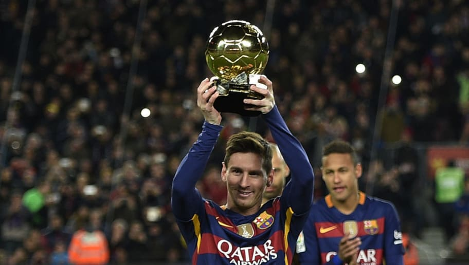 TOPSHOT - Barcelona's Argentinian forward Lionel Messi poses with his fifth Ballon d'Or trophy before the Spanish league football match FC Barcelona vs Athletic Club Bilbao at the Camp Nou stadium in Barcelona on January 17, 2016. / AFP / LLUIS GENE        (Photo credit should read LLUIS GENE/AFP/Getty Images)