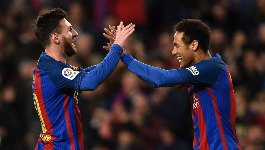 TOPSHOT - Barcelona's Argentinian forward Lionel Messi (L) celebrates with Barcelona's Brazilian forward Neymar (R) after scoring a goal during the Spanish league football match FC Barcelona vs RC Celta de Vigo at the Camp Nou stadium in Barcelona on March 4, 2017. / AFP PHOTO / LLUIS GENE        (Photo credit should read LLUIS GENE/AFP/Getty Images)