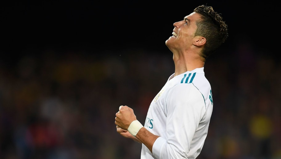 TOPSHOT - Real Madrid's Portuguese forward Cristiano Ronaldo reacts after missing a goal opportunity during the Spanish league football match between FC Barcelona and Real Madrid CF at the Camp Nou stadium in Barcelona on May 6, 2018. (Photo by LLUIS GENE / AFP)        (Photo credit should read LLUIS GENE/AFP/Getty Images)
