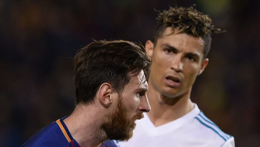 TOPSHOT - Real Madrid's Portuguese forward Cristiano Ronaldo (R) looks at Barcelona's Argentinian forward Lionel Messi during the Spanish league football match between FC Barcelona and Real Madrid CF at the Camp Nou stadium in Barcelona on May 6, 2018. (Photo by Josep LAGO / AFP)        (Photo credit should read JOSEP LAGO/AFP/Getty Images)