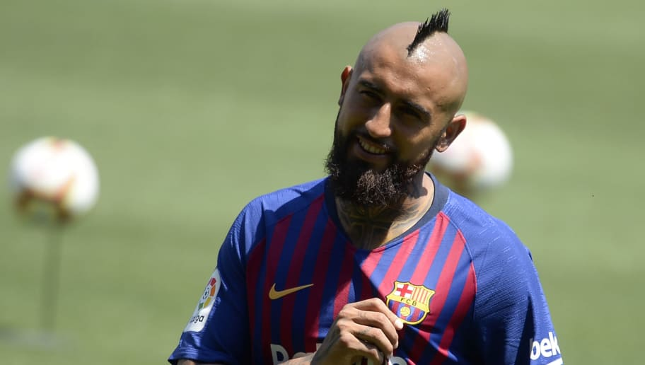 TOPSHOT - Barcelona's new player Chilean midfielder Arturo Vidal poses during his official presentation at the Camp Nou stadium in Barcelona on August 6, 2018. (Photo by Josep LAGO / AFP)        (Photo credit should read JOSEP LAGO/AFP/Getty Images)