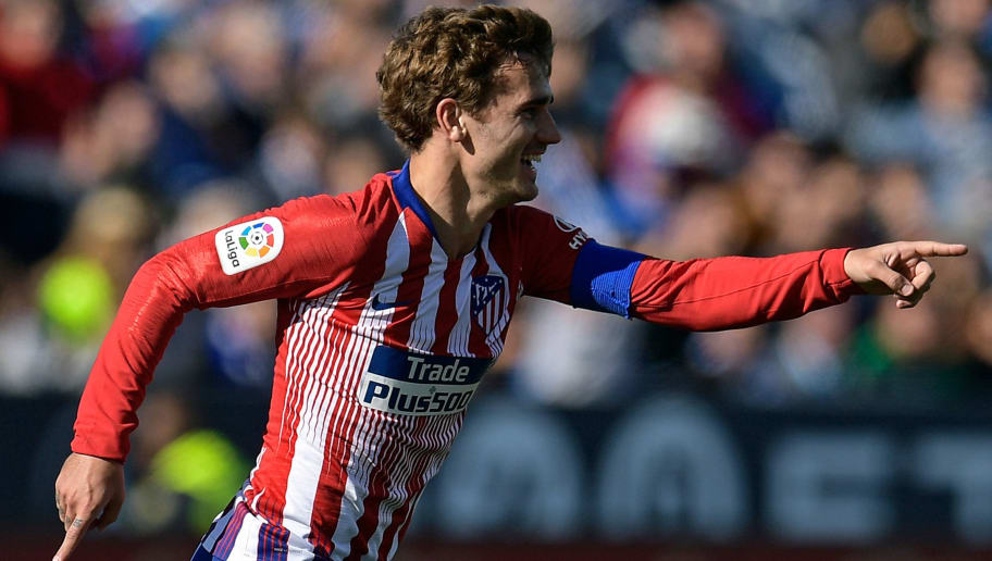 TOPSHOT - Atletico Madrid's French forward Antoine Griezmann celebrates after scoring the opening goal during the Spanish league football match between Club Deportivo Leganes SAD and Club Atletico de Madrid at the Estadio Municipal Butarque in Leganes on November 3, 2018. (Photo by OSCAR DEL POZO / AFP)        (Photo credit should read OSCAR DEL POZO/AFP/Getty Images)